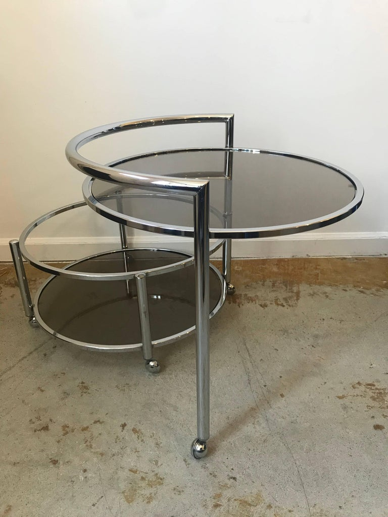 American Round Mid-Century Two-Tier Expandable Chrome & Smoke Glass Side or Coffee Table For Sale