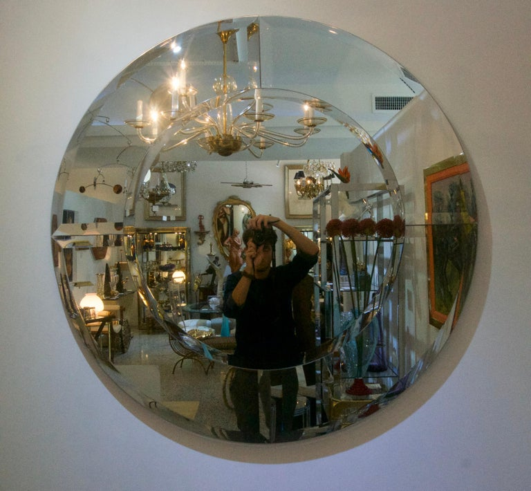 This large scale and clean lined Art Deco style wall mirror is in the manner of a mirror designed by Karl Springer.  Note: Projects from wall 1.50