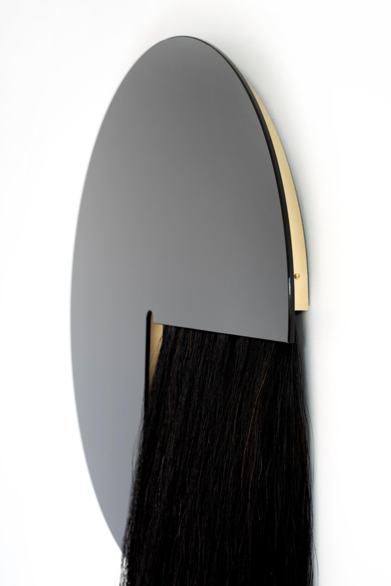 The Aries mirror partners Mongolian horsehair and mirror to create a juxtaposition of material and texture.