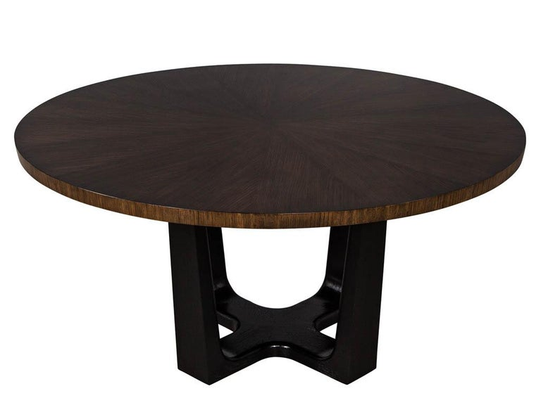 Roundmodern walnut dining table with sunburst top by Carrocel. Exquisite walnut sunburst top beautifully finished in a rich walnut perched upon a modern ebonized oak base. Newly made in Canada.  Price includes complimentary scheduled curb side