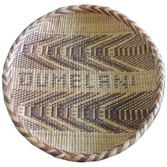 Round Natural and Brown Woven Tribal Basket with Braided Rim