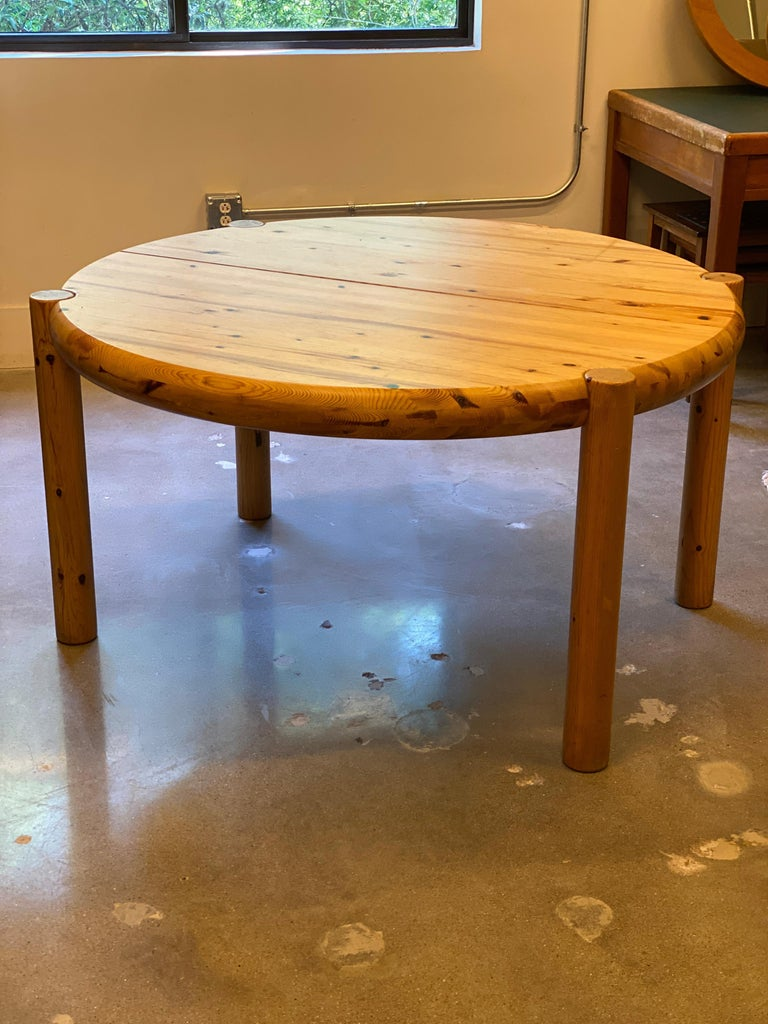 Mid-Century Modern or Scandinavian Modern dining table designed by Rainer Daumiller, Danish architect and designer. Round with four legs and extendable to oval with 23