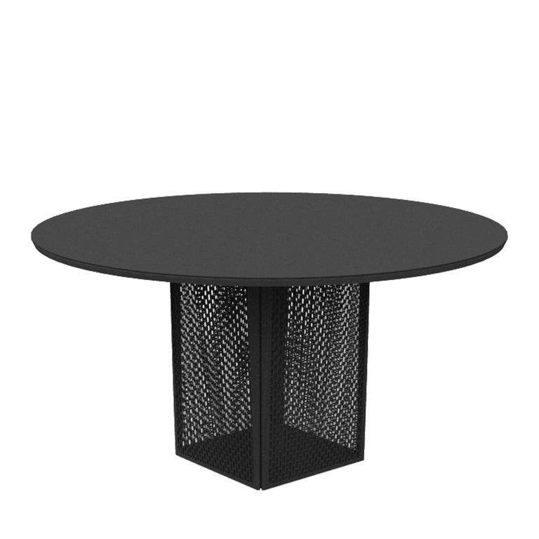 This round table's perforated base seems to be punctured by the wind, allowing its study, large, circular top to seemingly defy gravity by appearing to almost float upon the air. Its uniquely processed aluminum structure offers a play of