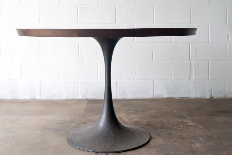 We have our tulip style base for a round pedestal base dining table, hand cast by the artisans at Sloss Furnaces historic foundry, here in Birmingham. A study in modern style and simplicity, the silhouette of the black patina base contrasts with the