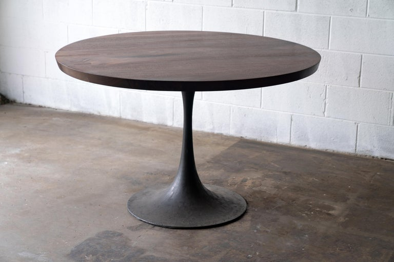 Steel Round Pedestal Base Dining Table Solid Walnut Wood Top on Hand Cast Tulip Base For Sale