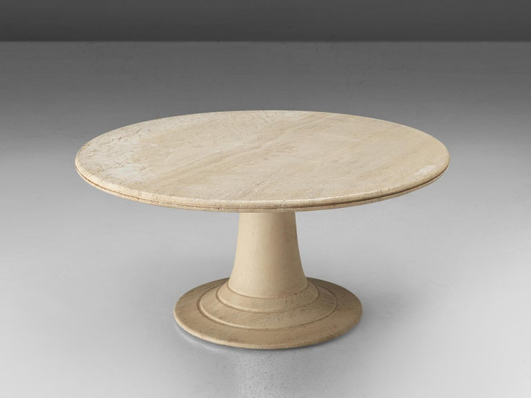 Coffee table, travertine, Europe, 1970s  Beautiful coffee table completely executed in travertine. The base consists of a round pedestal that gets wider towards the base to which it seems to float over. The base itself is highlighted with three