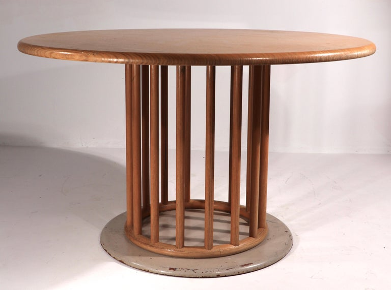 Chic, stylish, and sophisticated dining table made in Germany, designed by Helmut Lubke. The table feature the signature constructed wood top ( 1.5 in. thick x 47.5 in. Dia. ) with a doweled pedestal base ( 20.5 in. Dia. ) on a heavy iron base ( 28