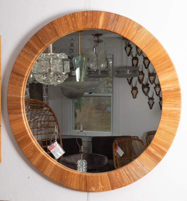 Round rattan surround mirror.