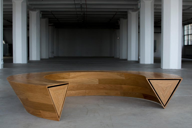 Round & Round is a circular communal bench and storage unit that is balanced on one single line. Though appearing to be a solid mass, as one end of the bench is pushed, the opposing side pops open revealing itself to be a continuous hidden drawer.