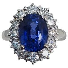 Round Sapphire and Diamond Ring with 18 Karat White Gold