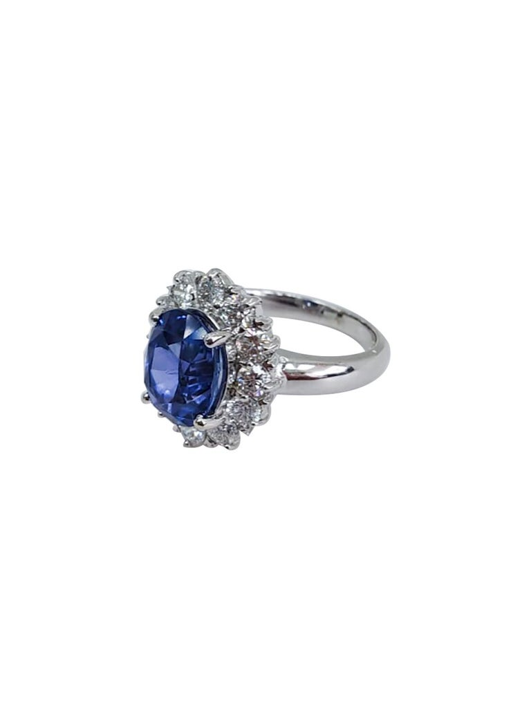 Round Cut Round Sapphire and Diamond Ring with 18 Karat White Gold For Sale