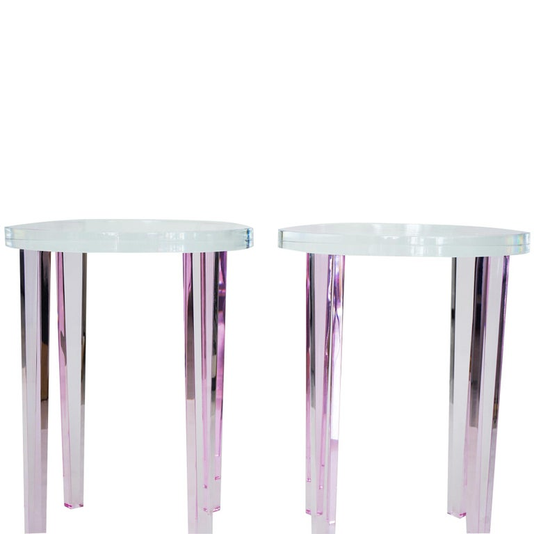 A pair of two handmade small side or cocktail tables made with clear and pink Lucite. Our Aurelia side table has been built with pink Lucite legs and a clear Lucite top. This little side table will reflect light and create a big impact. Designed by