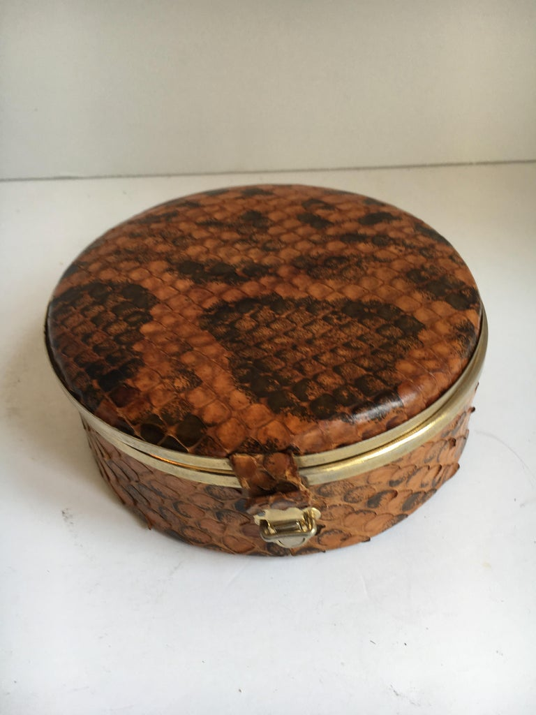 Round snakeskin box with brass detail and closure - a very handsome box of real snakeskin - well made and ready for any shelf or office space - store old letter, jewelry or 420 in this box - a lovely addition to any room with style, adding a