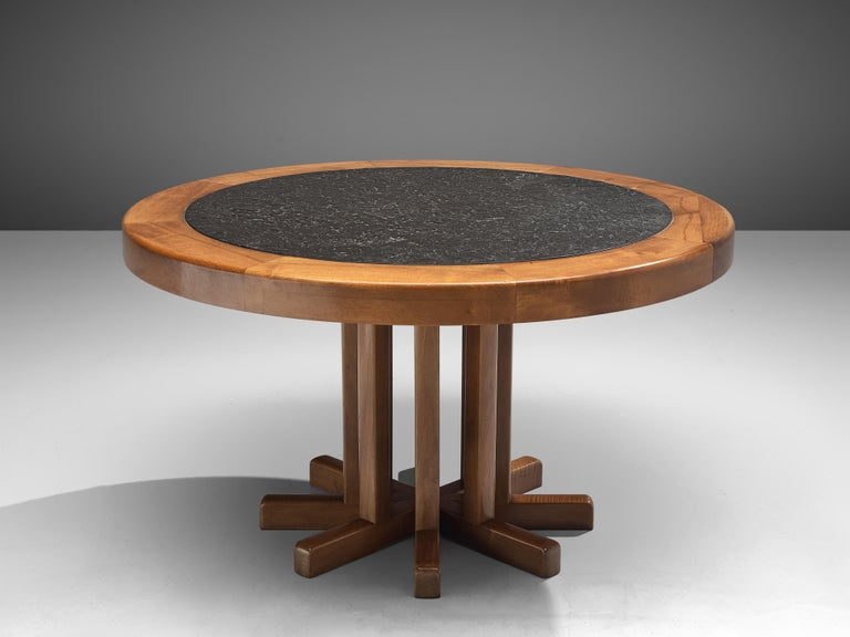 Round dining table, elm, slate, France, 1970s  This French dining table shows a wonderful combination of materials and well-balanced forms. Both the tabletop and the base catch the eye. The pedestal base consists of eight wooden slats arranged in a