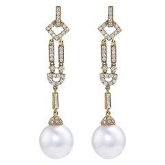 Round South Sea Pearl Drop Earrings, .69 Carat of Diamonds in 18 Karat Gold