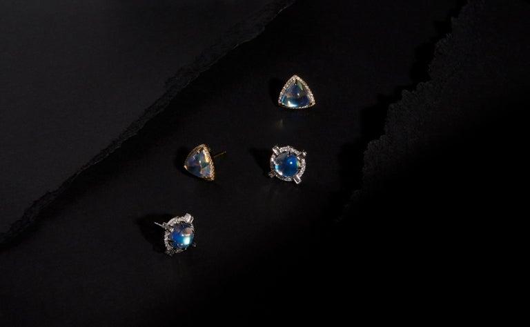 Round starburst moonstone and diamond stud earrings in 18k white gold.