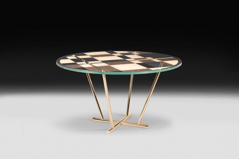 Round-shaped table, featured by a modern elegant design, inspired by the pictures of the famous Dutch painter Piet Mondrian and his usual geometries.  Part of unNatural collection, it comes out from a research on natural phenomena as well as