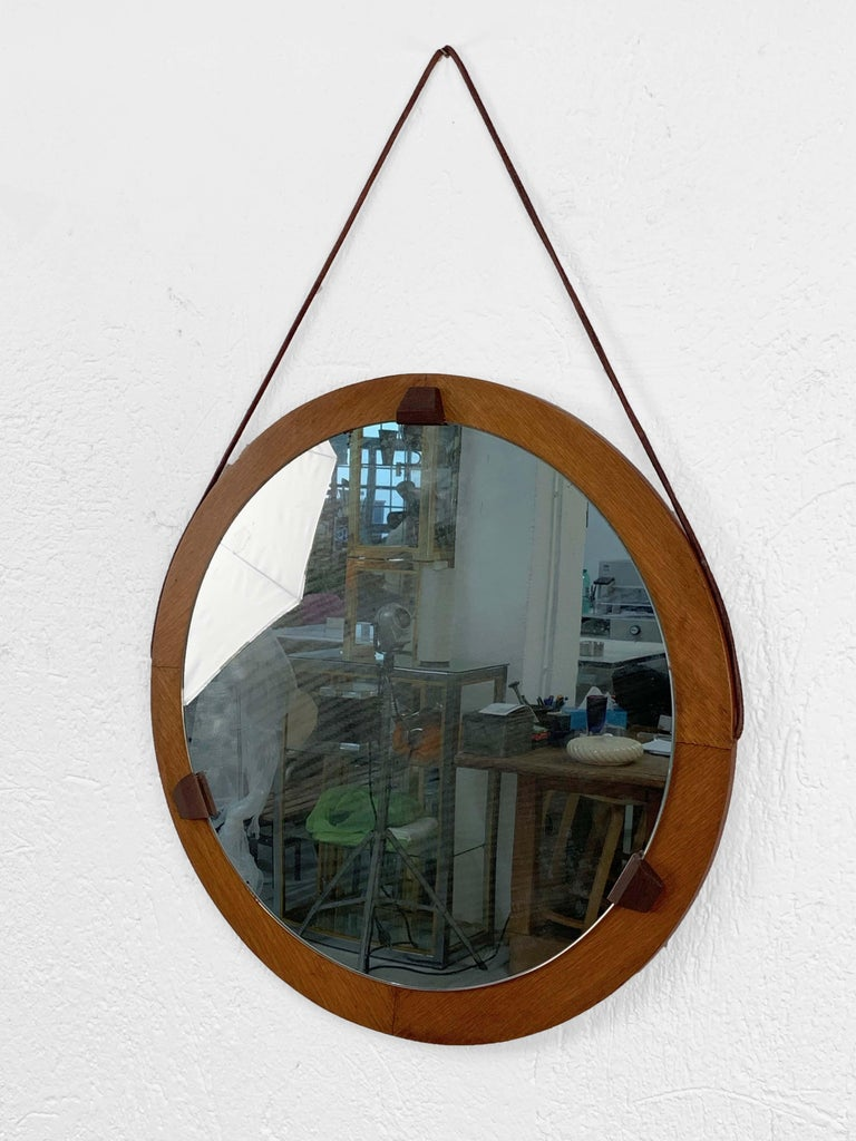 1960s round mirror, teak structure. Leather details. Vintage, signs of use of time.