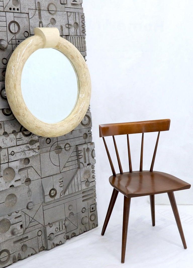 Mid-Century Modern medium size round tessellated bone frame wall mirror. Attributed to Enrique Garcel.