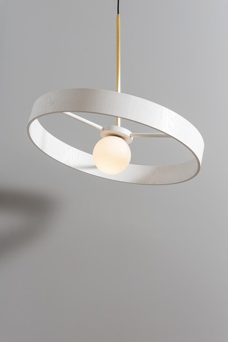Round thin pendantby ASAF Weinbroom Studio Dimensions: Ø70 x 57 cm Materials: Ball glass + Wood + Brass  Canopy: Brass Cord fabric: Black 2m Wattage / Type socket: 15w Max Led / E27 ASAF WEINBROOM studio was established in 2009.  All our