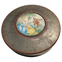 Round Tin Box with a Musician and Two Ladies Depicted on Top, Weaved Tin Design