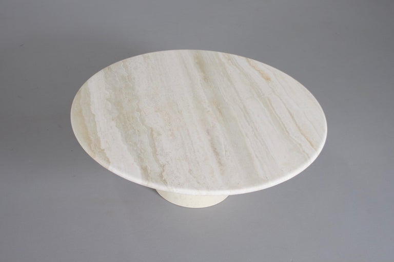 Round travertine coffee table in very good condition.   Manufactured by Up&Up Italy in the 1970s   The table has a round travertine top.   The base of the table is round and also made of solid travertine.  The travertine surface is
