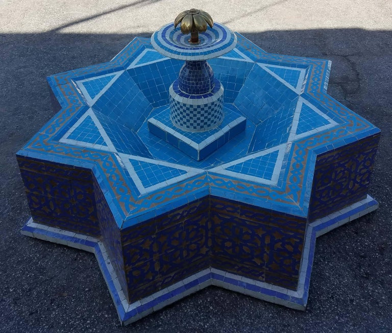 This is a typical Moroccan Mosaic fountain handmade in Marrakech. This fountain is usually found in courtyards and Riads all-over Morocco. It measures approximately 50 inches diameter and 22 inches height and weighs about 325 lbs.