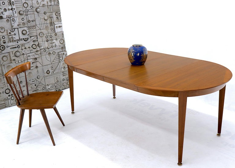 Mid-Century Modern walnut dining room table on tapered legs with 2 18