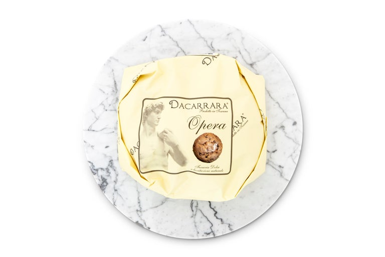 Rounded white Carrara marble cheese plate. Each piece is in a way unique (every marble block is different in veins and shades) and handmade by Italian artisans specialized over generations in processing marble. Slight variations in shape, color and