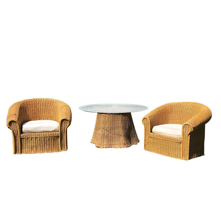 1970s round sculptural handcrafted Trompe L'oeil rattan draped-sheet or ghost table and matching chair set. The table is handwoven in warm honey-colored wicker and is meant to fool the eye with the illusion of a skirted table. The bottom of the