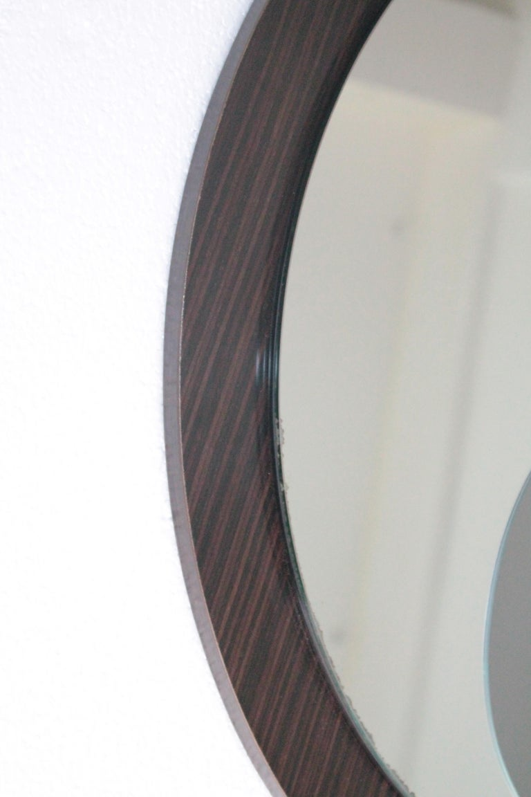 Round Italian mirror in wood and glass