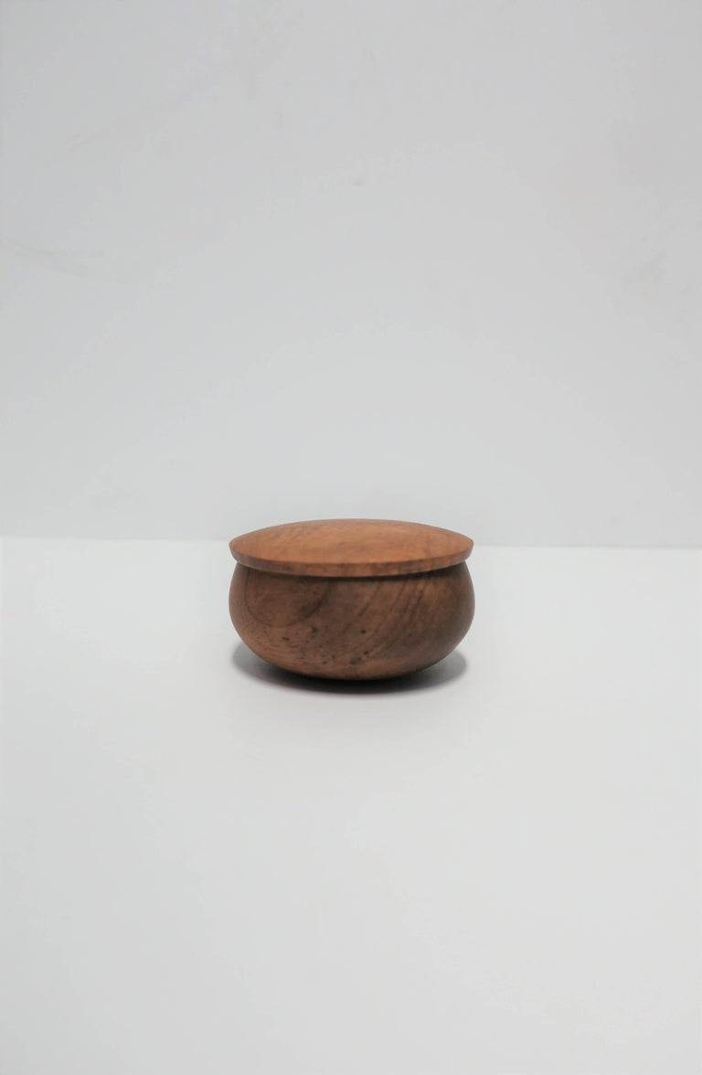 A small round wood trinket, jewelry, or vanity box. Piece is signed and dated on bottom as show in image #11. Dimensions: 1.75