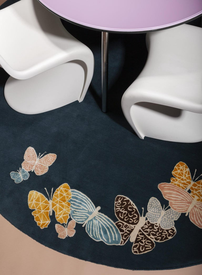 In Stock now! Sergio Mannino Studio's collection of rugs is expanded with two new designs. (See storefront to look at other items). Hand drawn butterflies seem to come out of the floor. The background is wool, while the butterflies are made with a