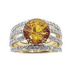 Round Yellow Sapphire with Diamond Set in 18 Karat Gold Settings