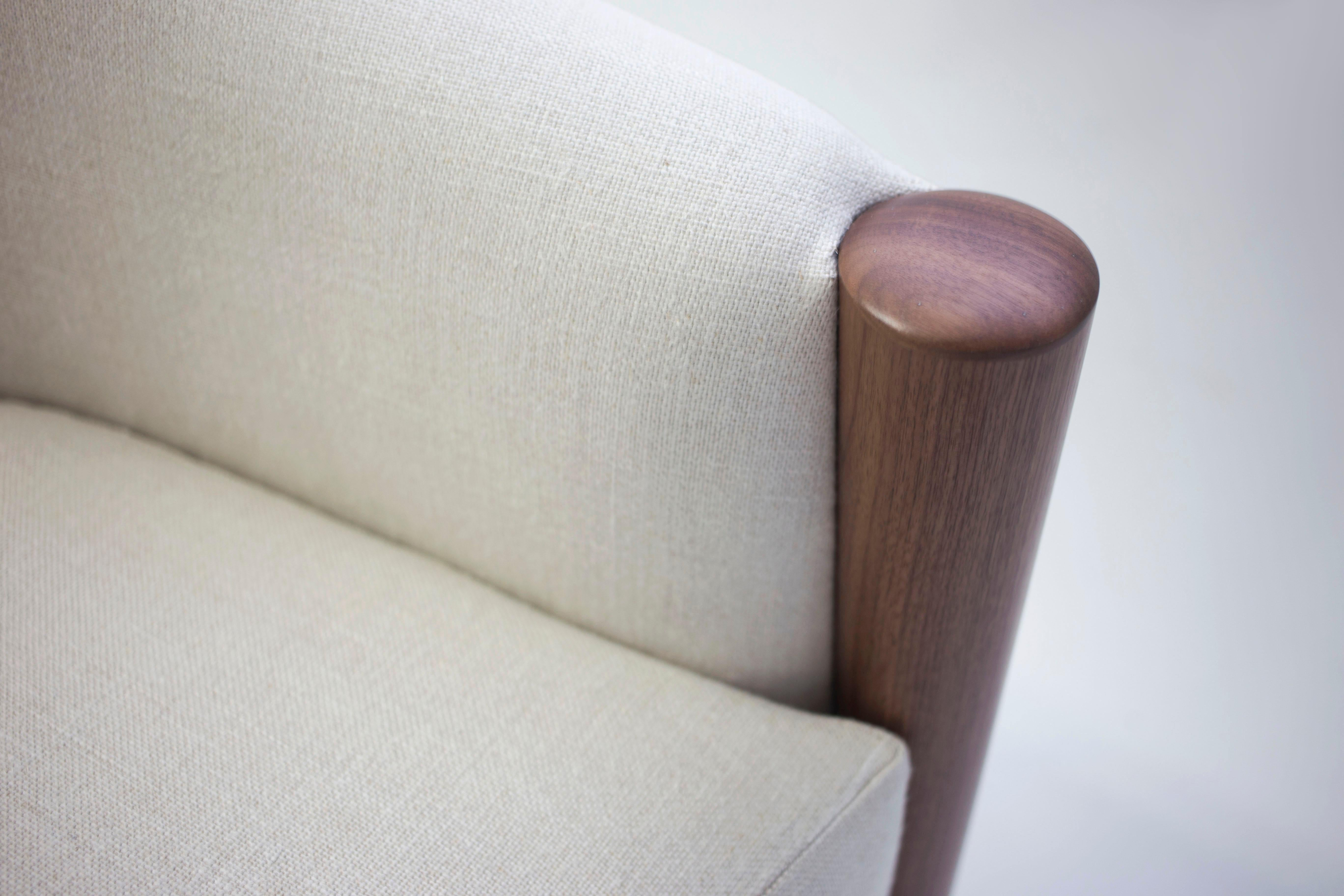 Rounded Tub Club Chair On Swivel Shown In Linen Fabric With Wood Arm Post Detail