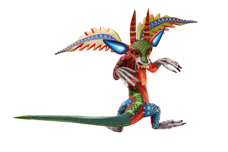 Dragon Fantastico - Fantastic Dragon Alebrije  This Mexican Fantastic Dragon Alebrije made with Copal wood, wood carving technique gouges, machete and sandpaper, decorated with acrylic paintings with Zapotec symbols. At Cactus Fine Art, we offer an