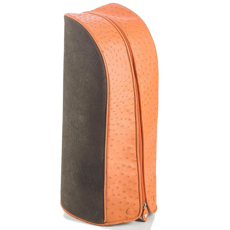 Part of the Royal collection, this exquisite golf bag is the ultimate accessory to showcase on the course. Its functionality is combined with a stunning look entirely handmade of ostrich leather in a bright orange color with inserts in brown
