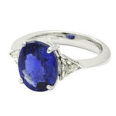 Royal Blue 8,27ct Tanzanite and White Triangle Diamond Engagement Ring