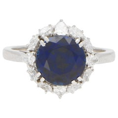 Royal Blue Sapphire and Diamond Cluster Engagement Ring Set in Platinum