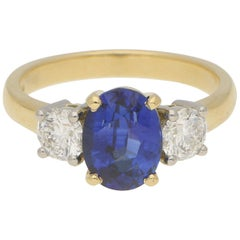 Royal Blue Sapphire and Diamond Three-Stone Engagement Ring Set in 18 Karat Gold