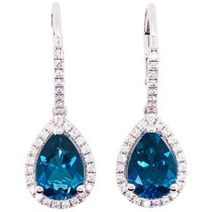 Royal Blue Topaz and Diamond Dangle Earrings in 14 Karat White Gold