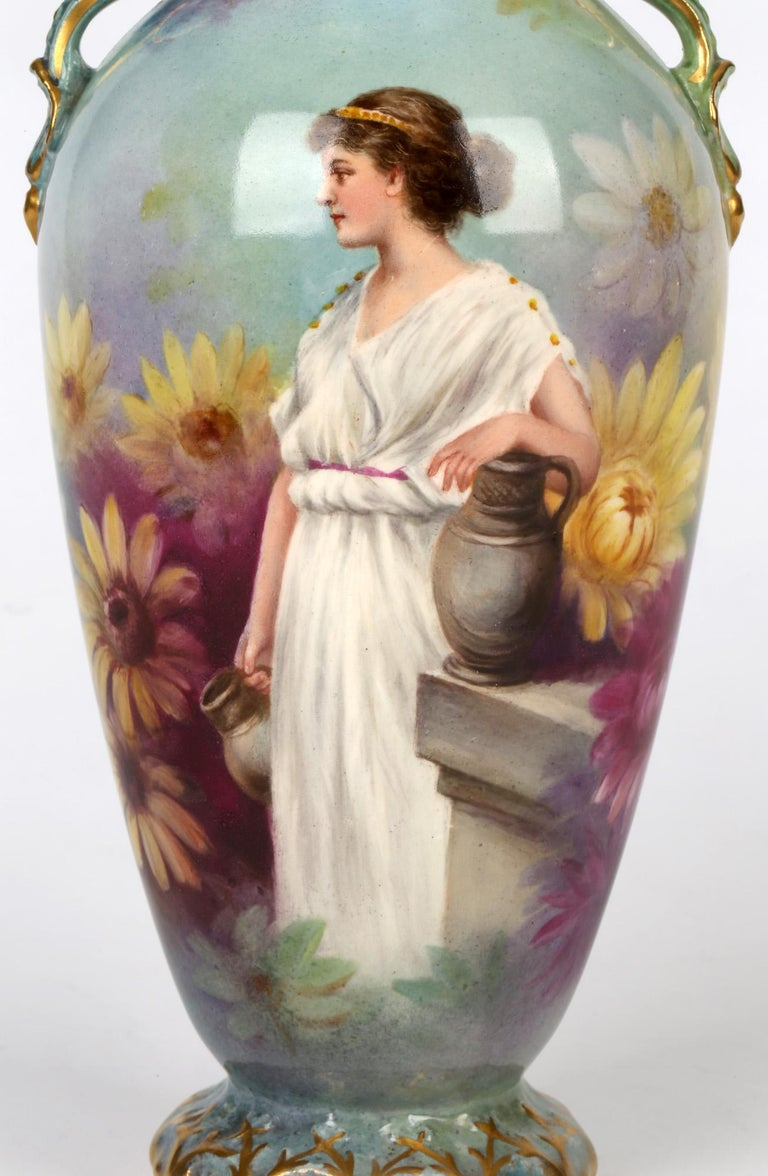 A very finely painted Art Nouveau German Royal Bonn twin handled pottery vase hand painted with a female water carrier by J Duren and dating from around 1900. This lightly potted vase is finely made standing on a rounded molded base with tall