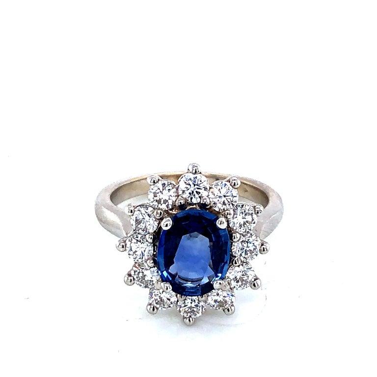 Discover this Royal Ceylon Sapphire and White Diamonds on White Gold Engagement Ring. Ceylon Sapphire 1,8 Carat Size 9/7 oval shape 12 Diamonds 1,2 Carat Brillant shape  White Gold 18 Carat  French Size 54  US Size 6 1/2 British Size N Resizing