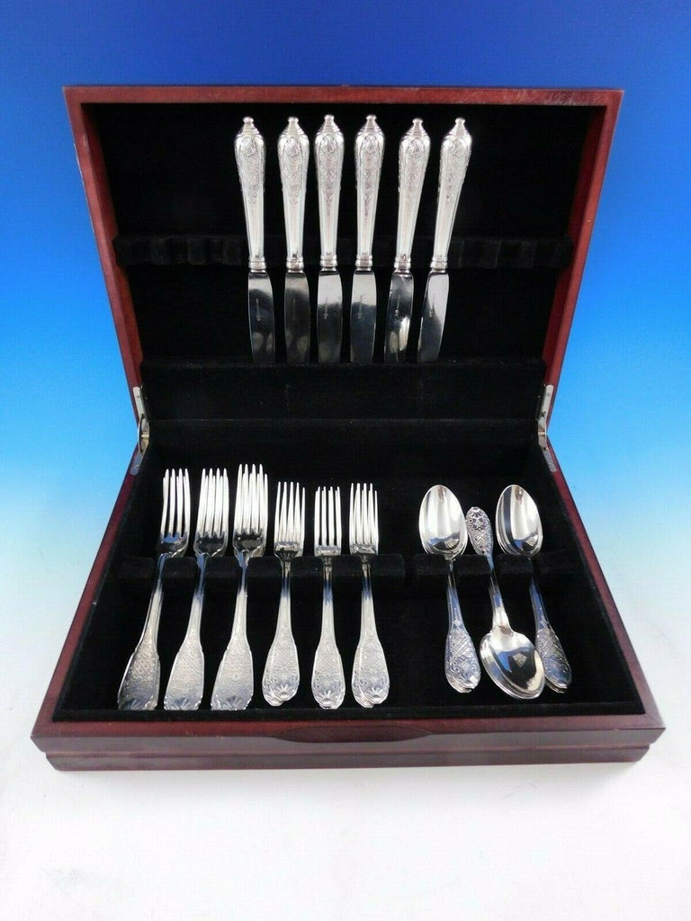Dinner size royal Cisele by Christofle or Cardeilhac sterling silver flatware set, 24 pieces. This set includes:  6 large dinner knives, cannon style handles, 10