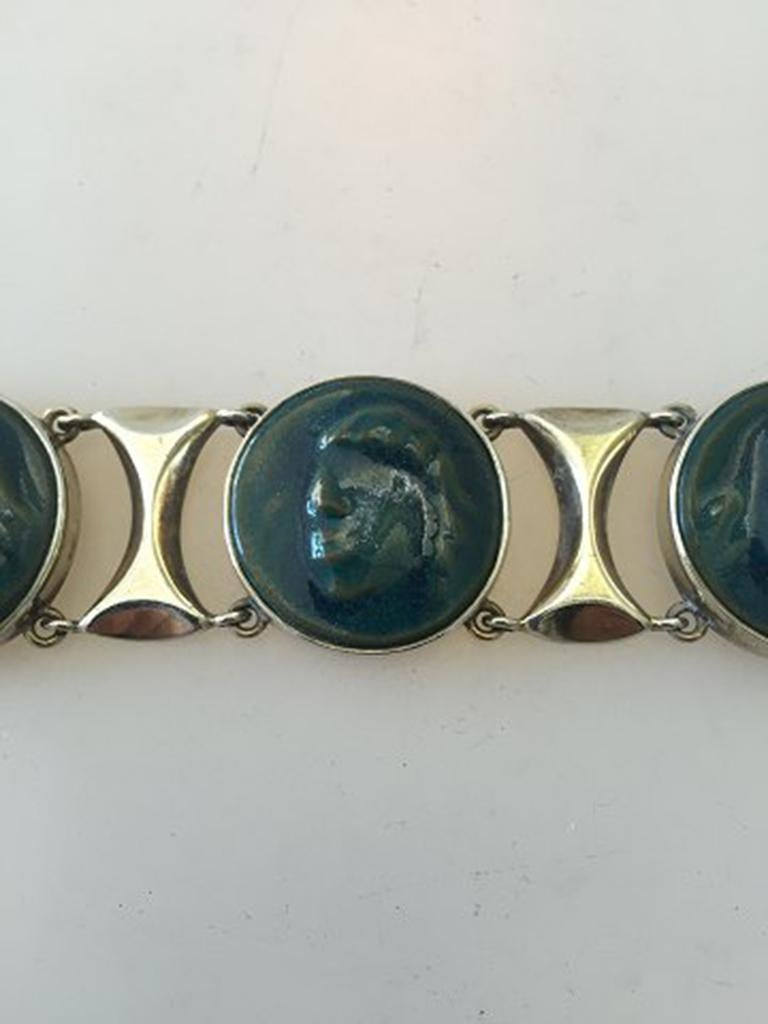 Royal Copenhagen A. Dragsted Jais Nielsen Sterling Silver and Porcelain Bracelet. Measures 16 cm / 6 19/64 in. Weighs 61 g / 2.15 oz. One disk has been glued.