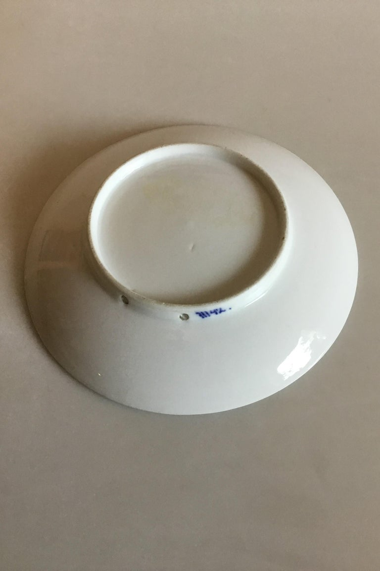 Royal Copenhagen commemorative plate from 1928 RC-CM255. Measures: 17 cm / 6 11/16 in. and is in good condition.