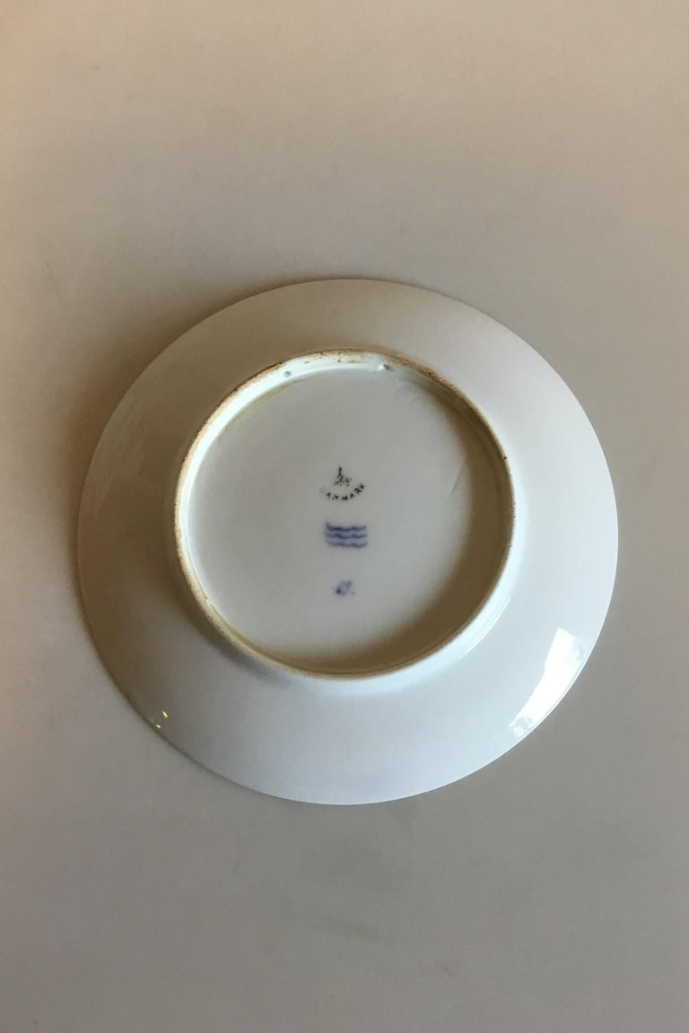 Royal Copenhagen commemorative plate from 1897 RC-CM14. Measures 18.5 cm and is in good condition.