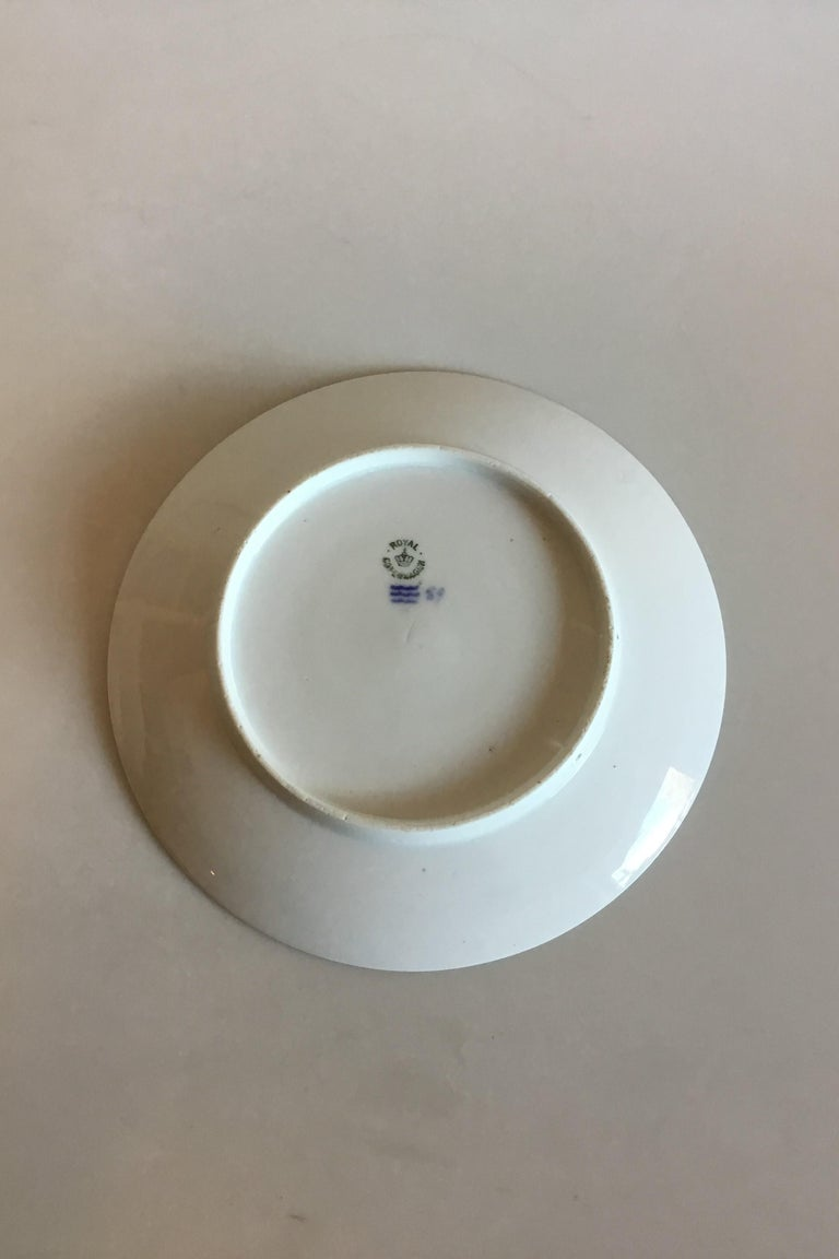 Royal Copenhagen commemorative plate from 1908 RC-CM81. Measures: 22.5 cm and is in good condition.