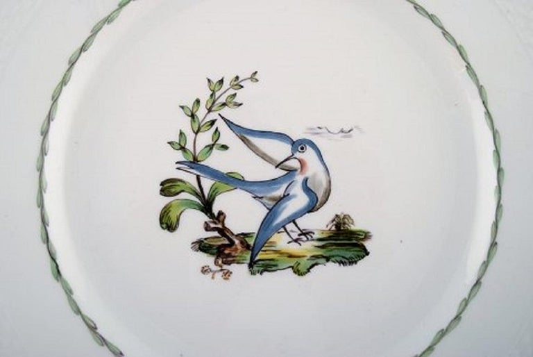 Royal Copenhagen dinner plate in hand painted porcelain with bird motifs and gold decoration. 