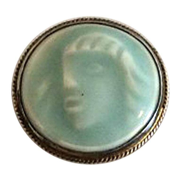 Royal Copenhagen Jais Nielsen Brooch from Dragsted Silversmithy in Celedon Glaze For Sale